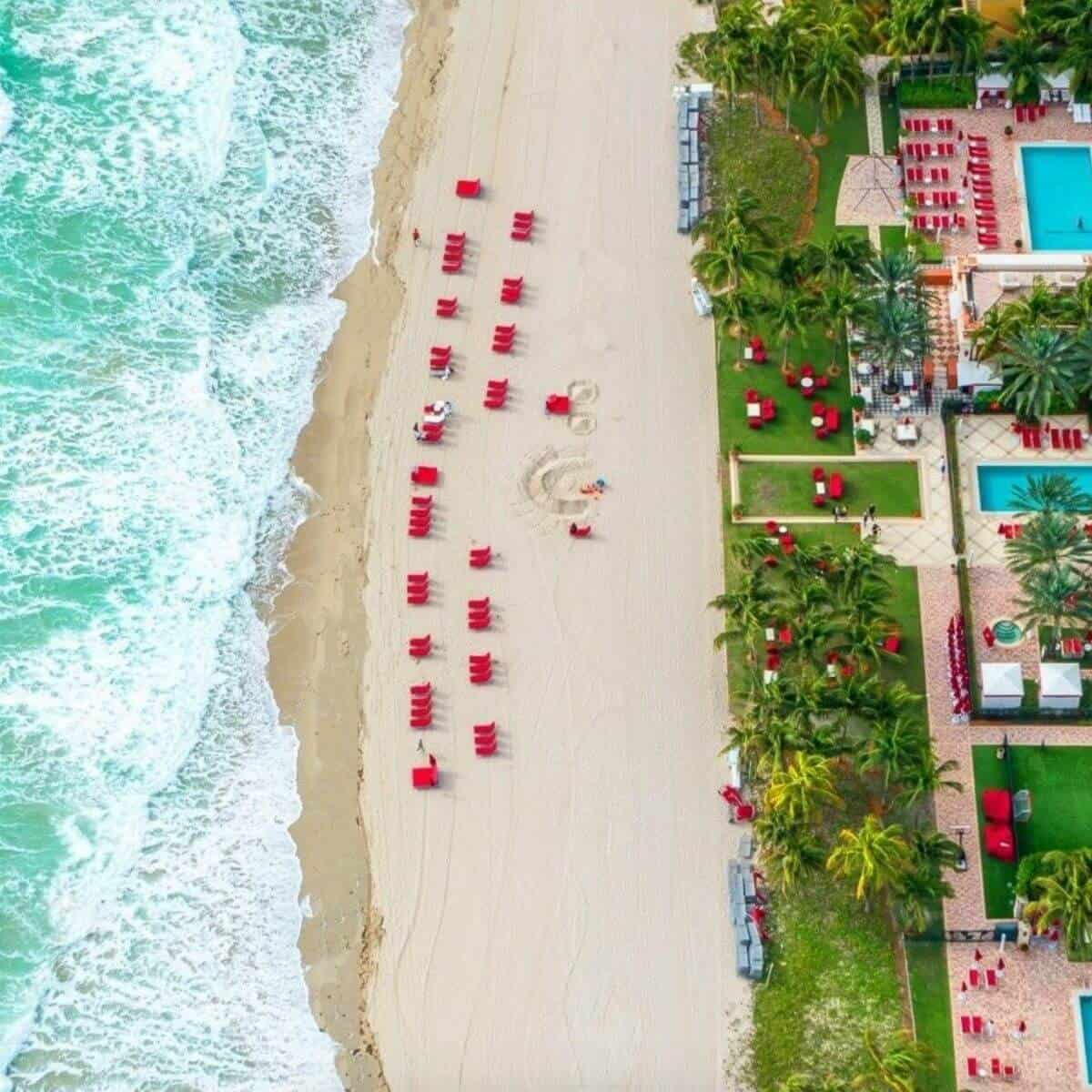 Aerial view of the beach and the pools at Acqualina Resort.