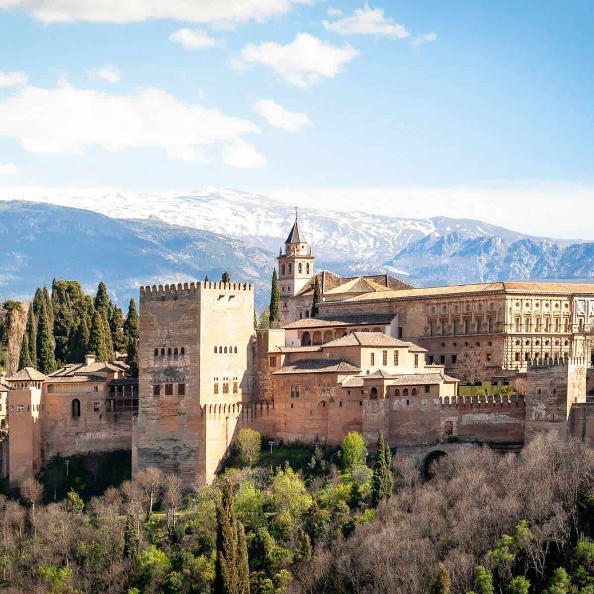 Alhambra palace in Spain with mountains in the background.
