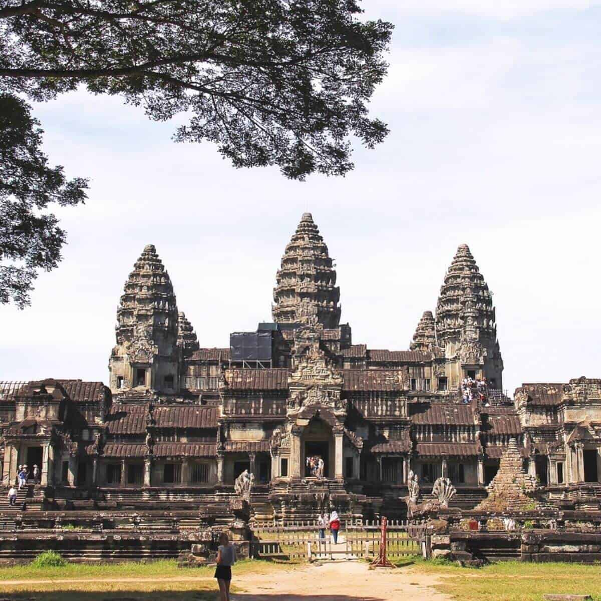 People entering the gate in front of Angkor Wat.