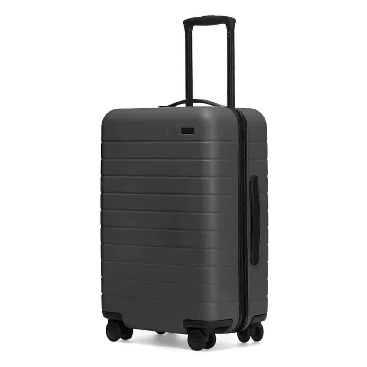 Dark grey hard-shell carry-on luggage by Away.