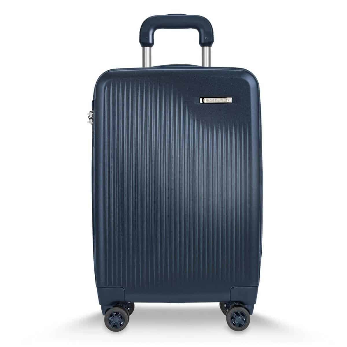Blue hard-shell carry-on by Briggs and Riley.