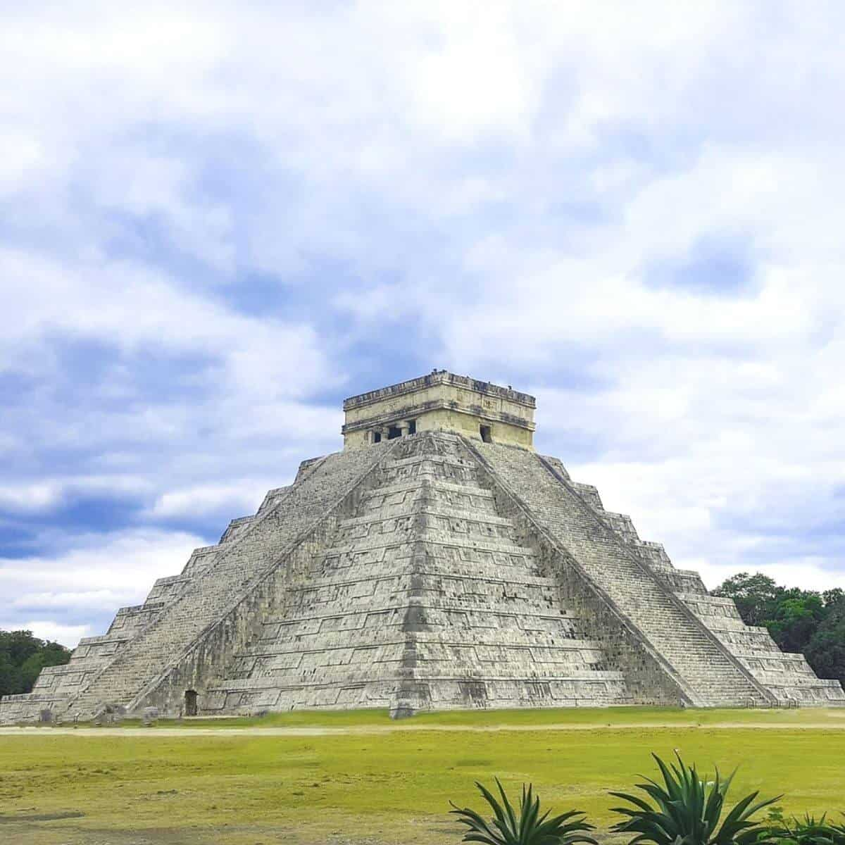 Chichen Itza on a partly cloudy day.