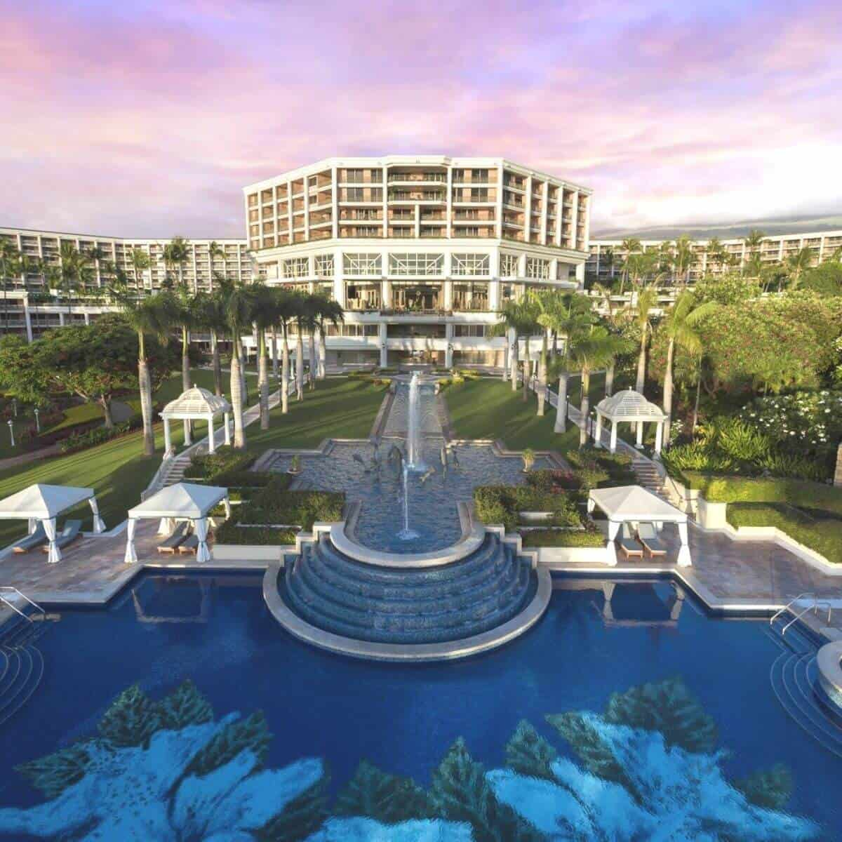 Front view of the Grand Wailea Maui Resort, the pool, and fountains.