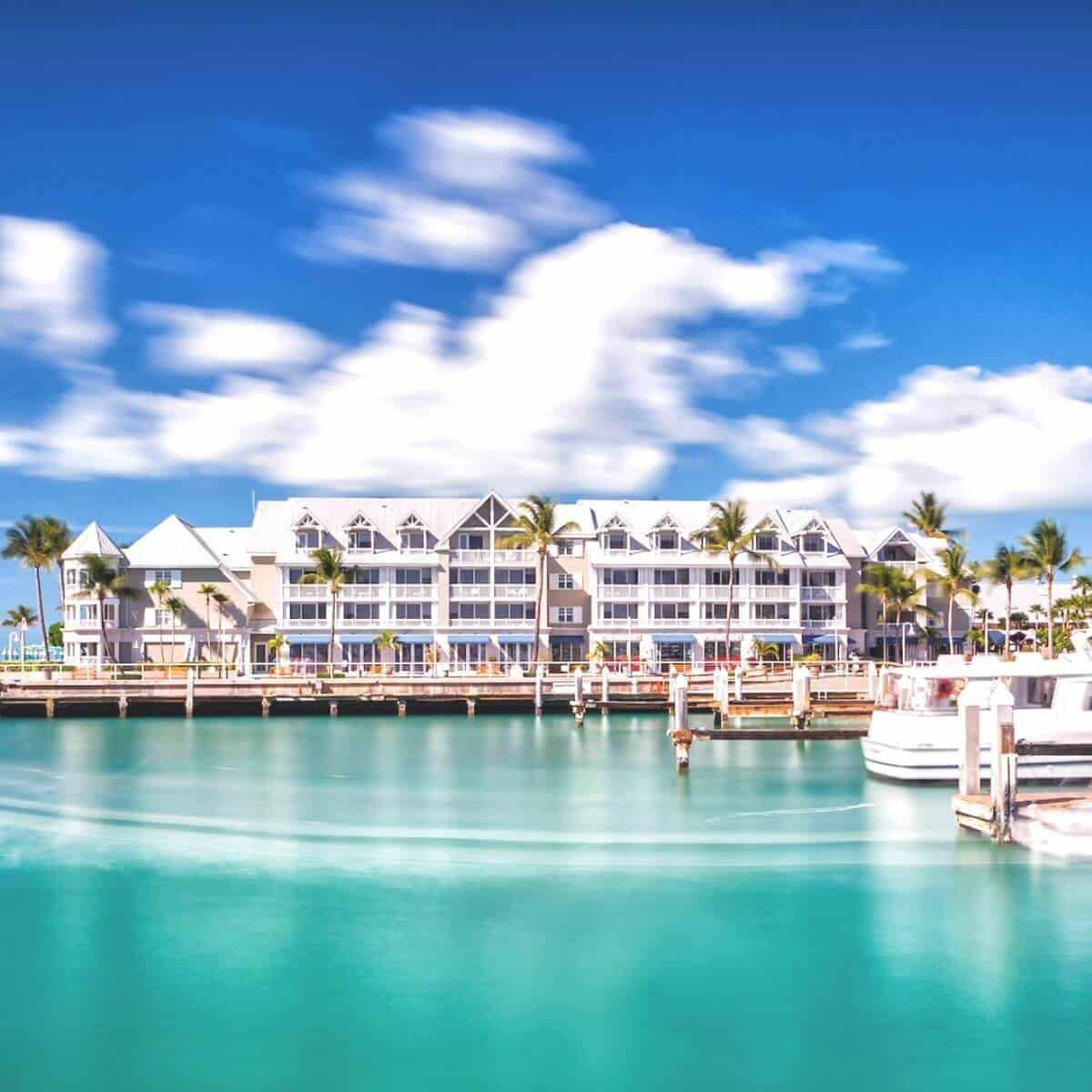 View of the exterior of Margaritaville Key West Resort on the water.