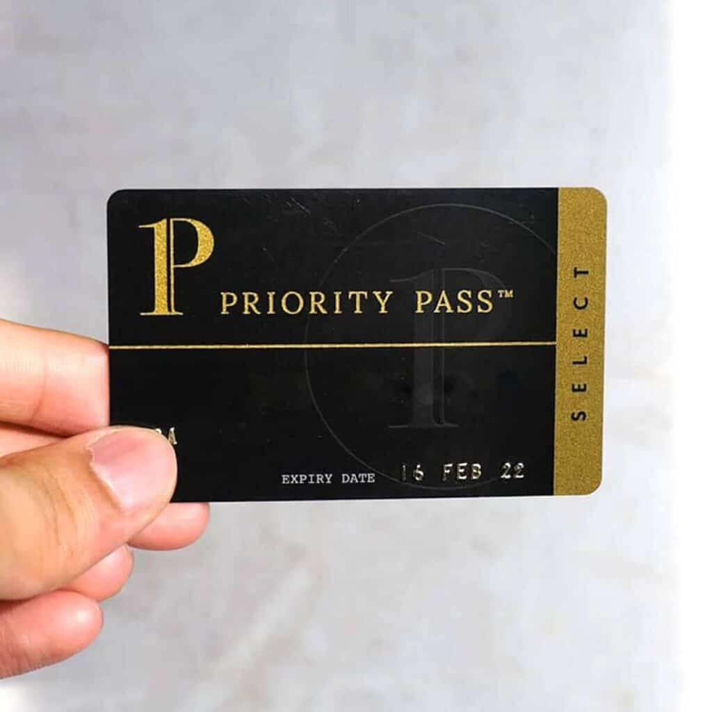 Close-up of a Priority Pass Select card being held.