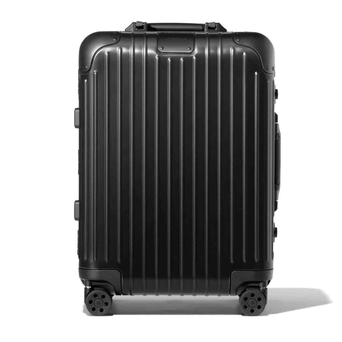 Black Rimowa carry-on luggage.