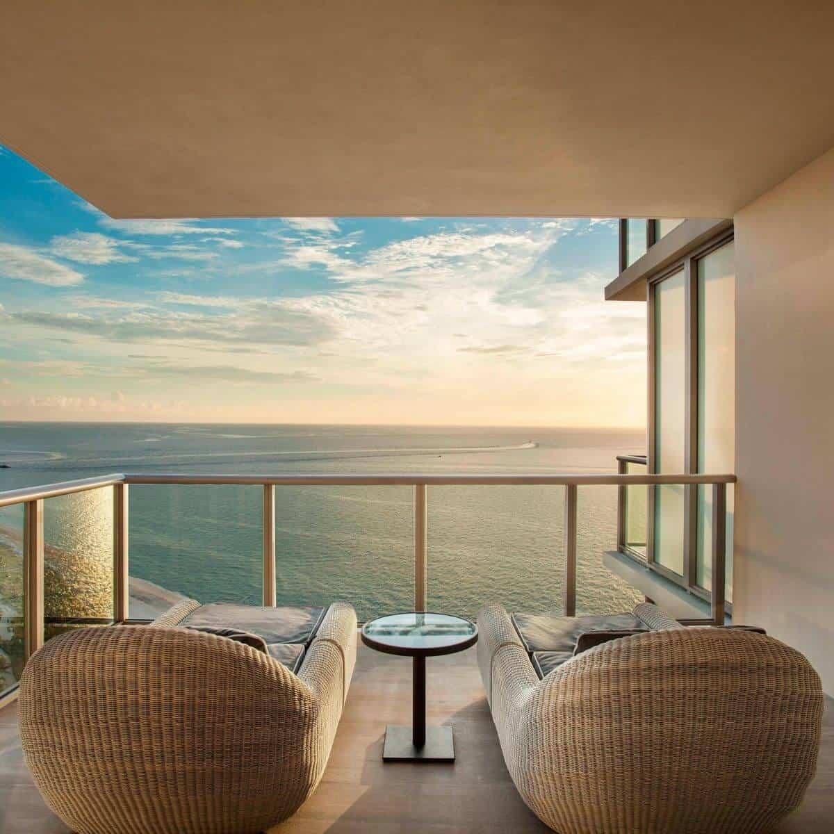 View of a sunset over the ocean from a balcony at the St. Regis Hotel in Bal Harbour.