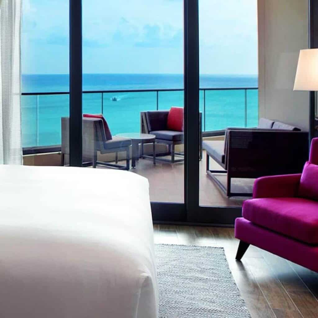 Hotel room with a patio and ocean view.