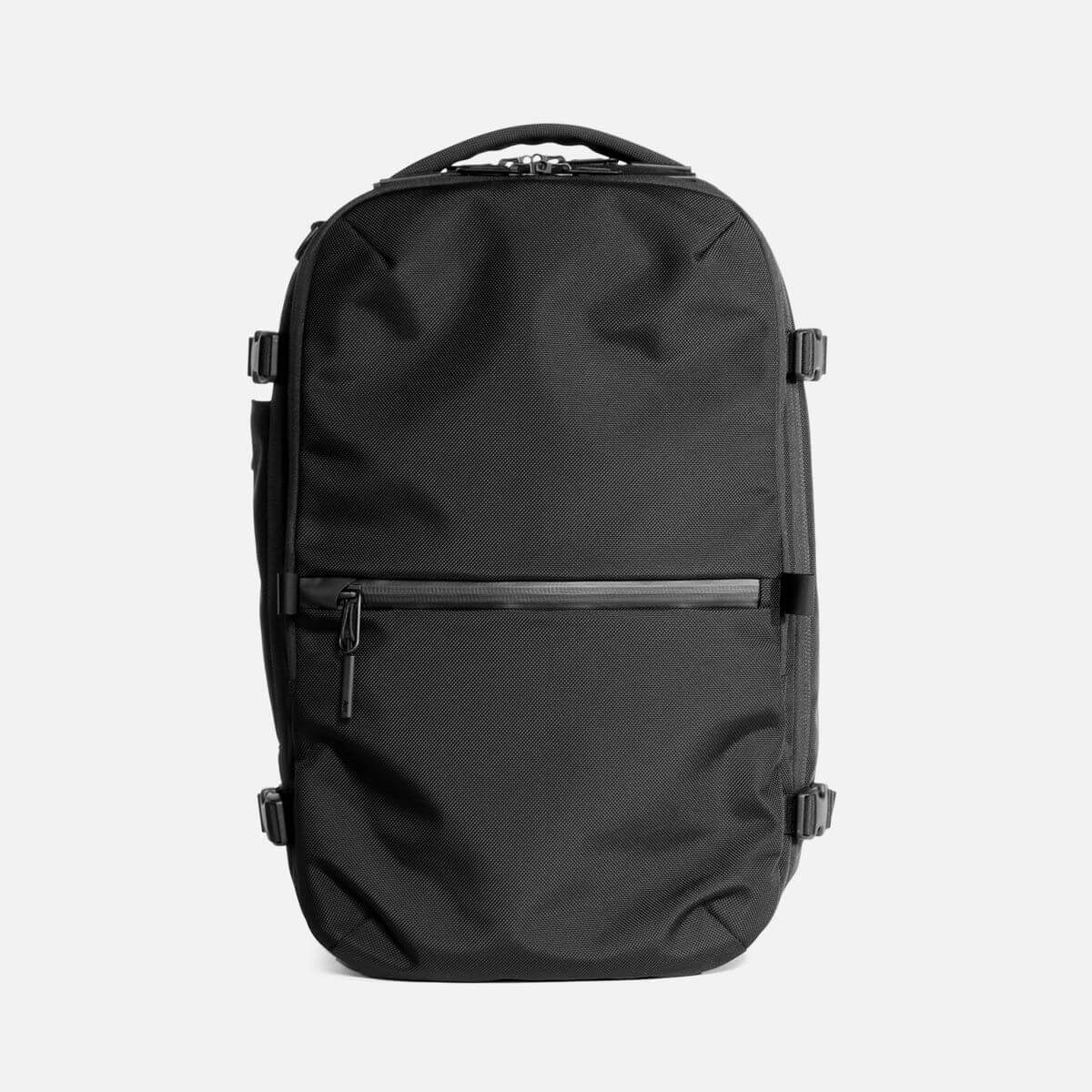 Black nylon travel backpack by Aer.
