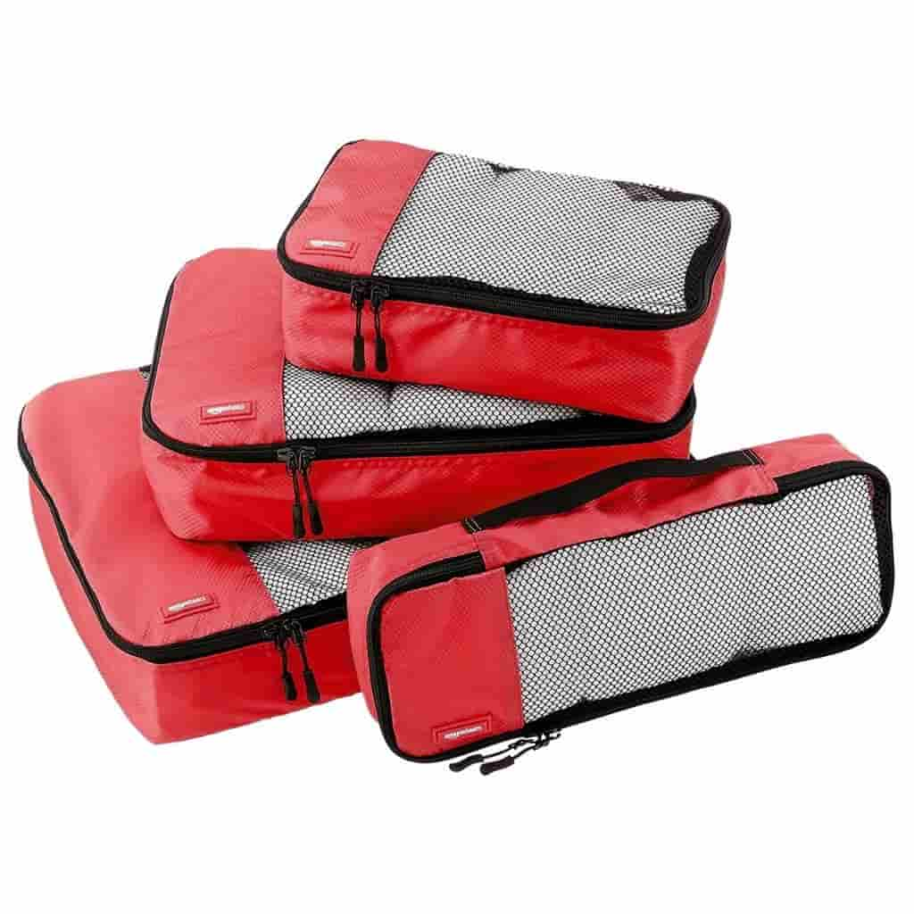 Four red mesh packing cubes.