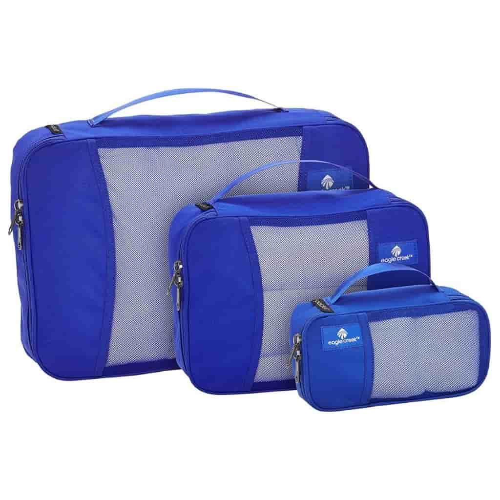 Three blue packing cubes of different sizes.