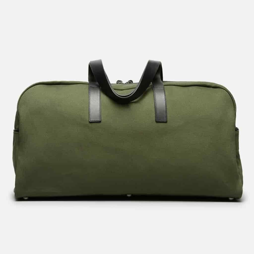 Dark green twill weekender bag by Everlane.