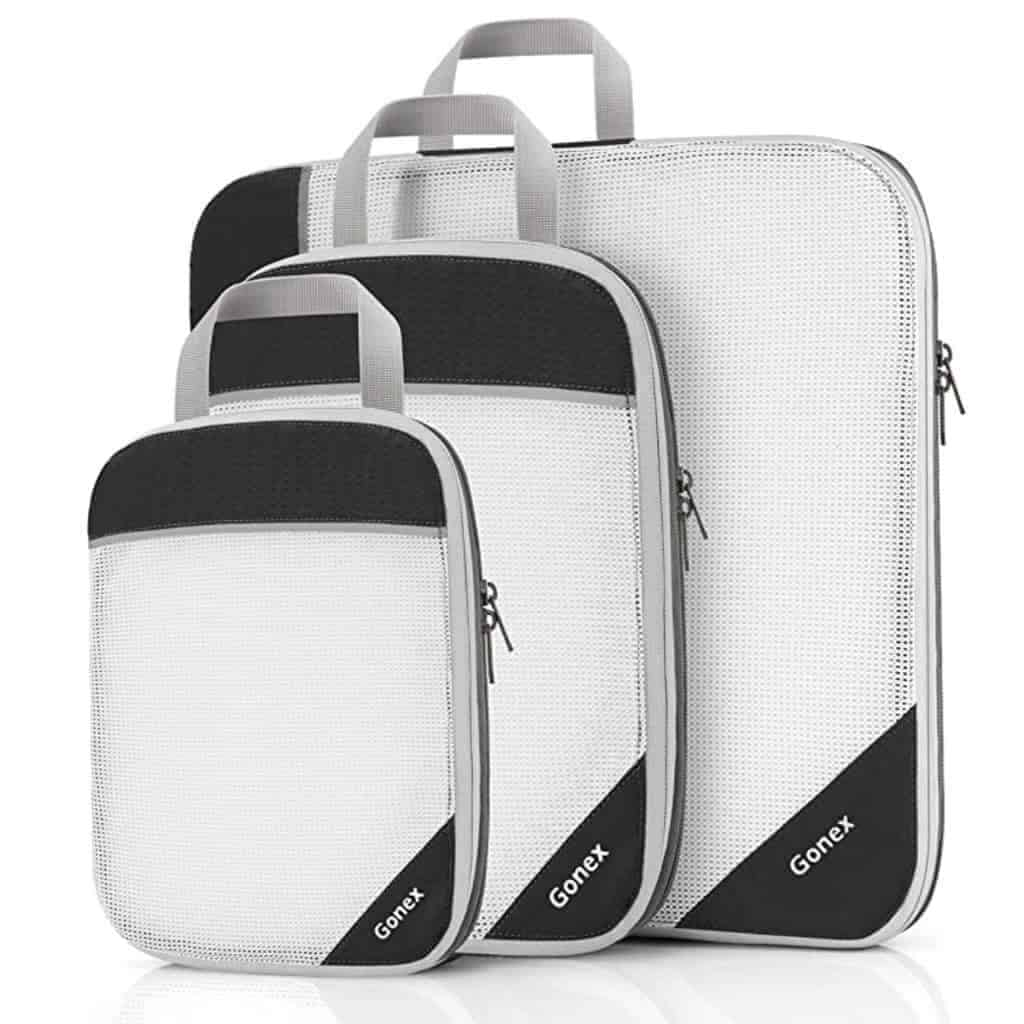 Three white and black mesh packing cubes.
