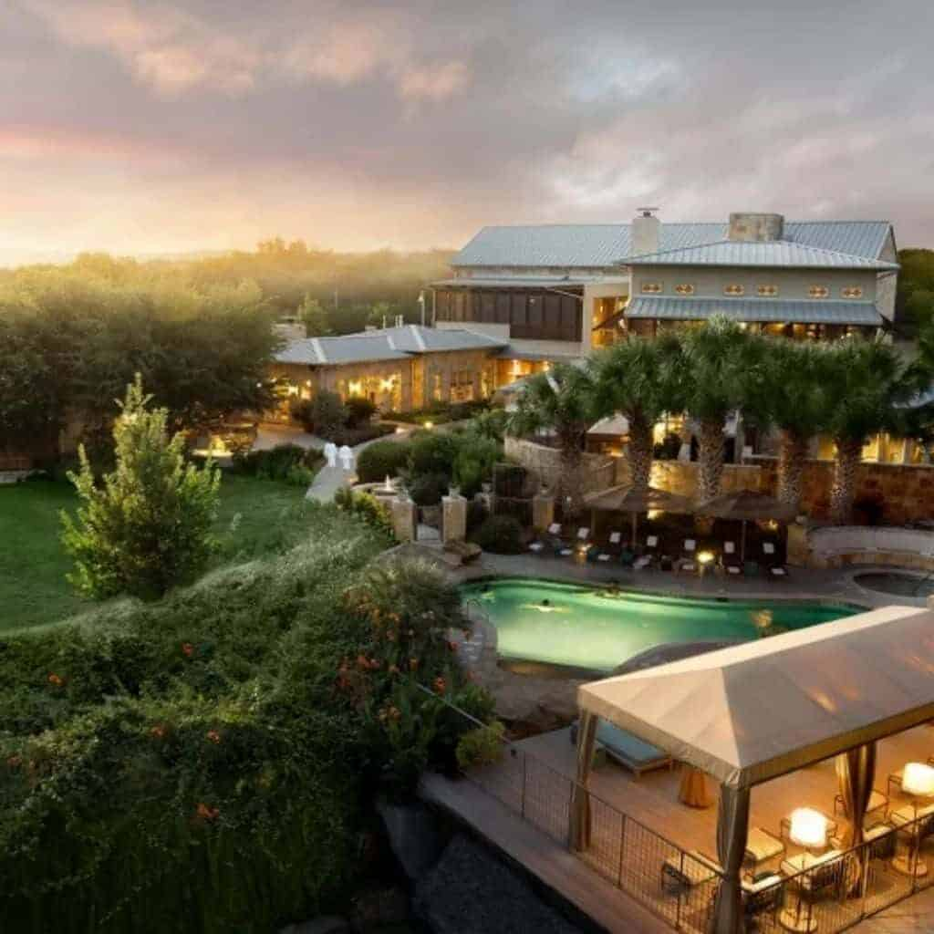 Exterior of Lake Austin Spa Resort and the outdoor pool.