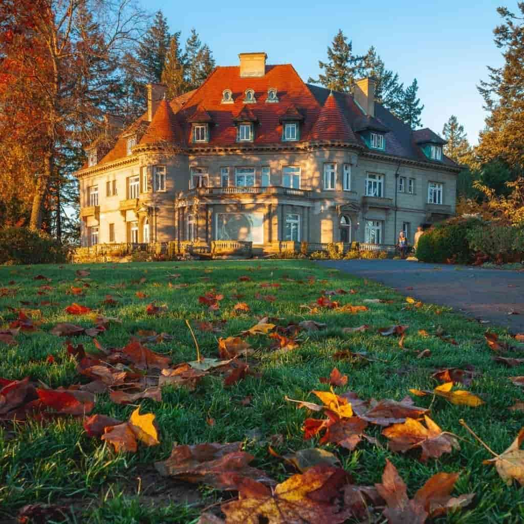 Exterior of Pittock Mansion with trees surrounding it.