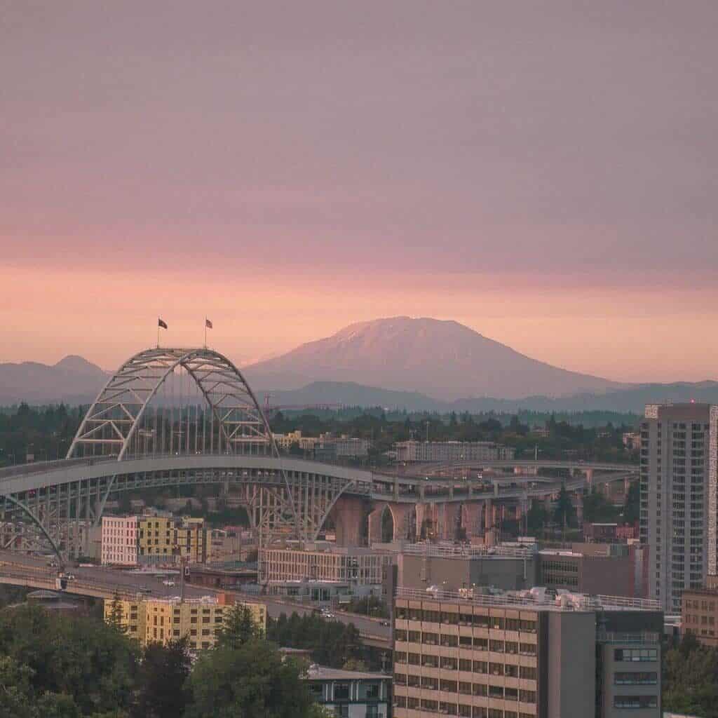 High-rise buildings, bridge, and mountain in Portland, Oregon.