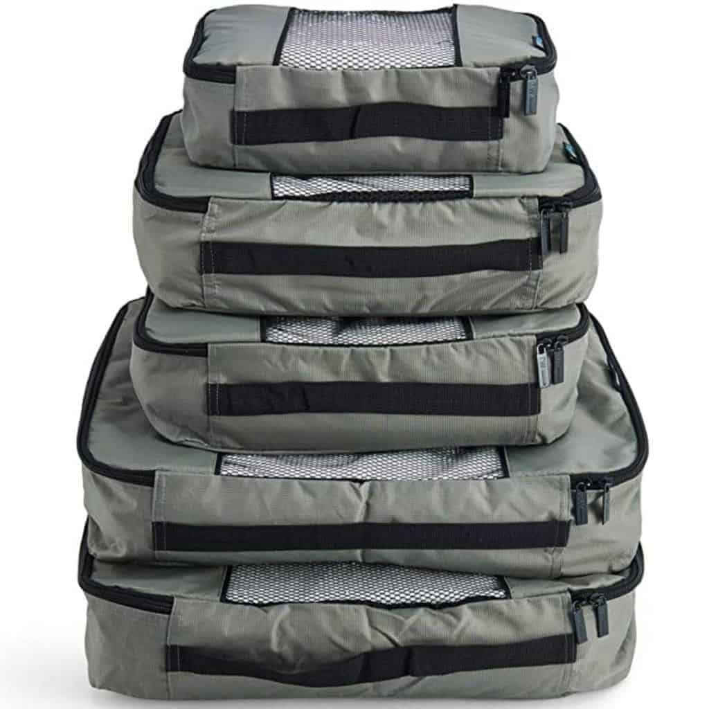 Stack of grey packing cubes.