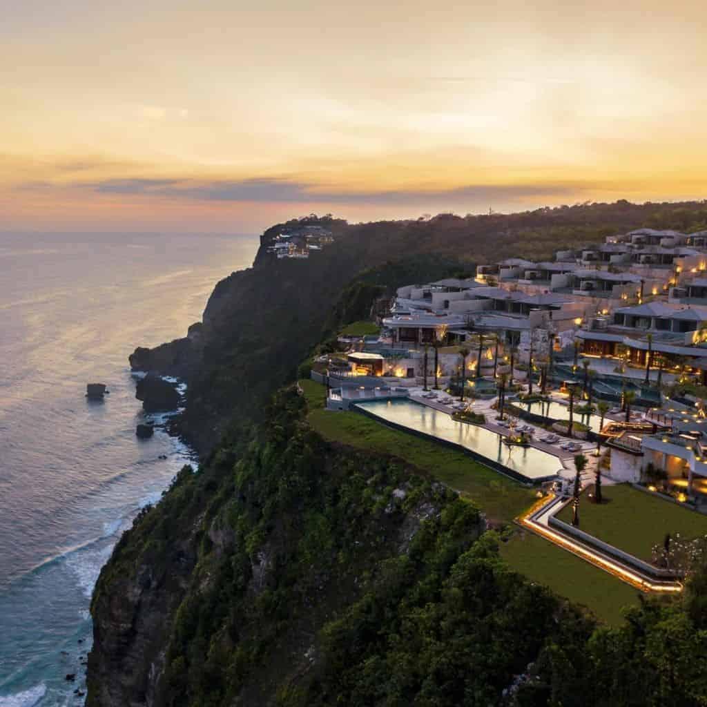 Aerial view of Six Senses Uluwatu Resort on a cliffside overlooking the ocean.