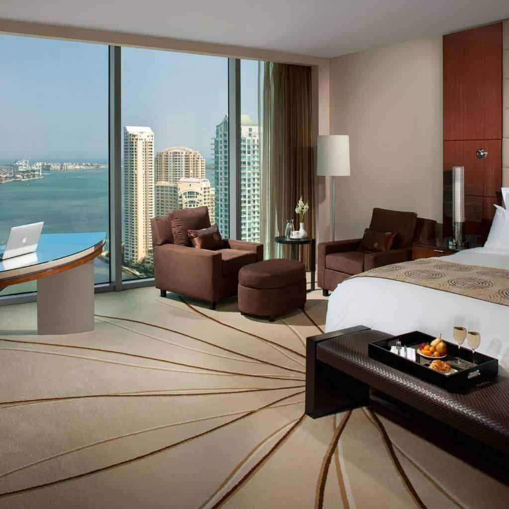 Guestroom at JW Marriott Marquis Miami with a view of the water and buildings.