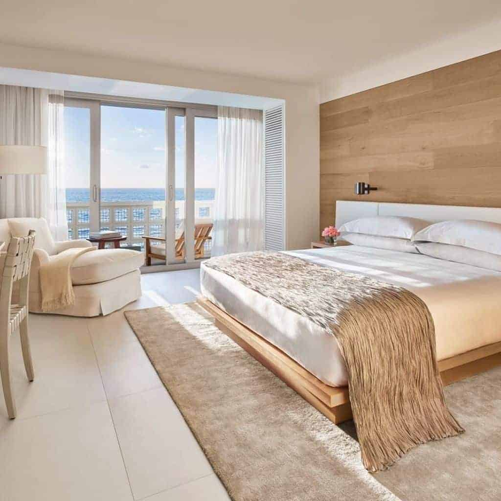 Guestroom at The Miami Beach Edition hotel with a water view.
