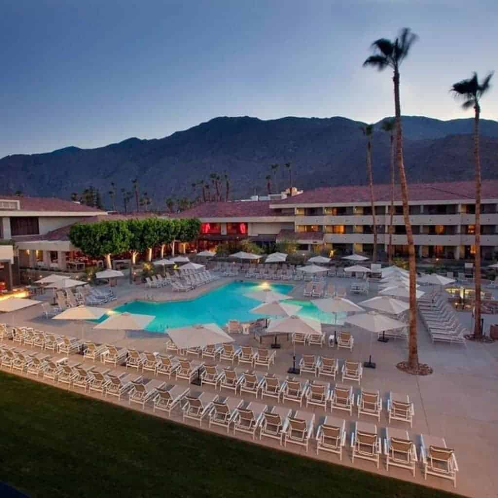 Pool and exterior of Hilton Hotel in Palm Springs.