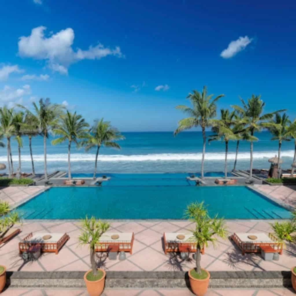 Pool overlooking the ocean at Legian Seminyak Hotel.