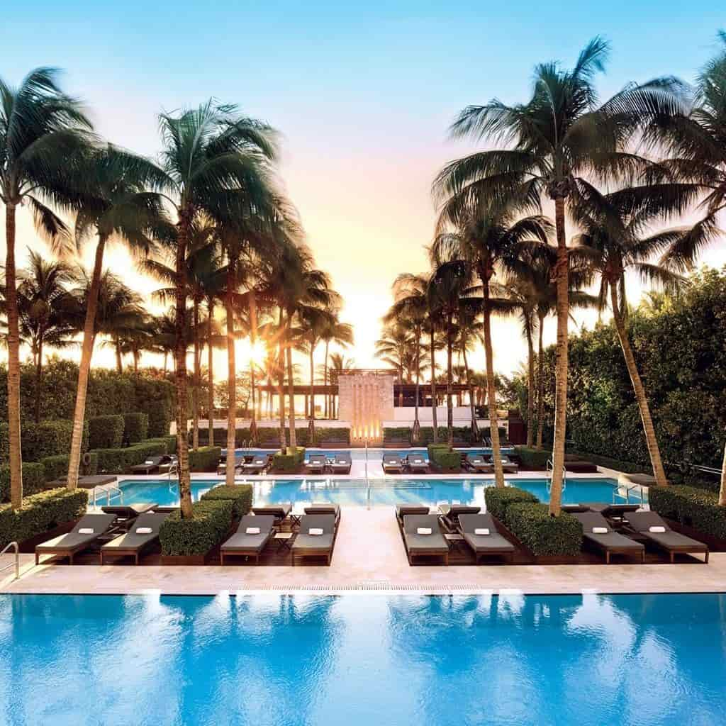 Pools, palm trees, and a sunset at The Setai Miami Beach.