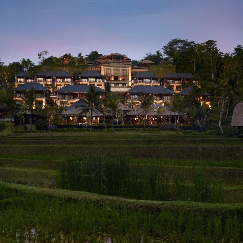 Grass fields and exterior of Mandapa Ritz-Carlton hotel.