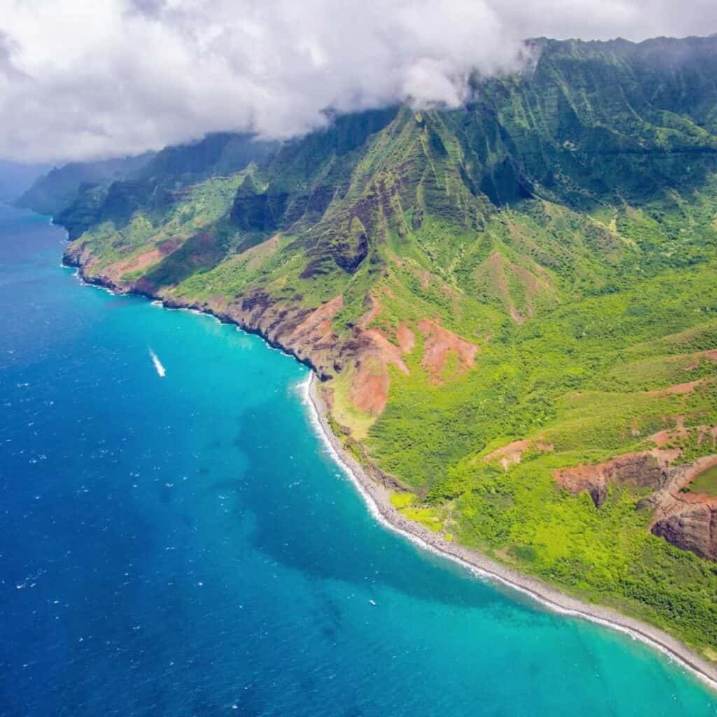 Aerial view of mountains and the ocean in Hawaii.