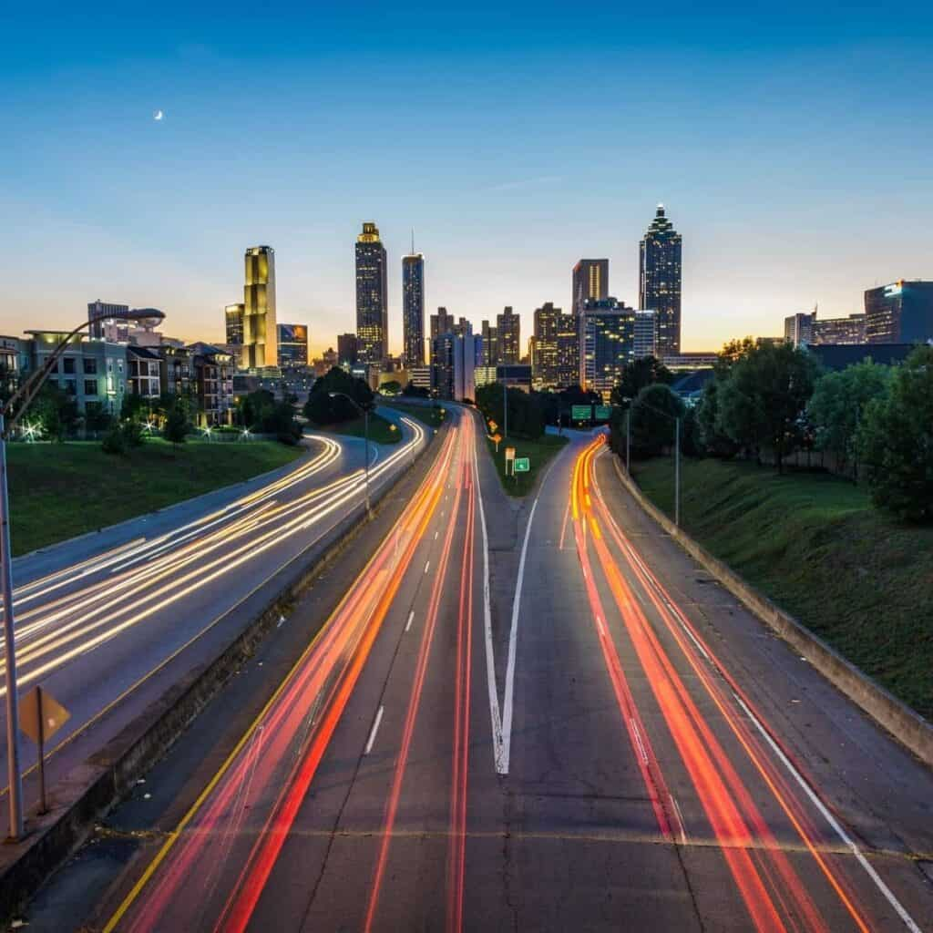 Long exposure of a freeway and the Atlanta skyline.