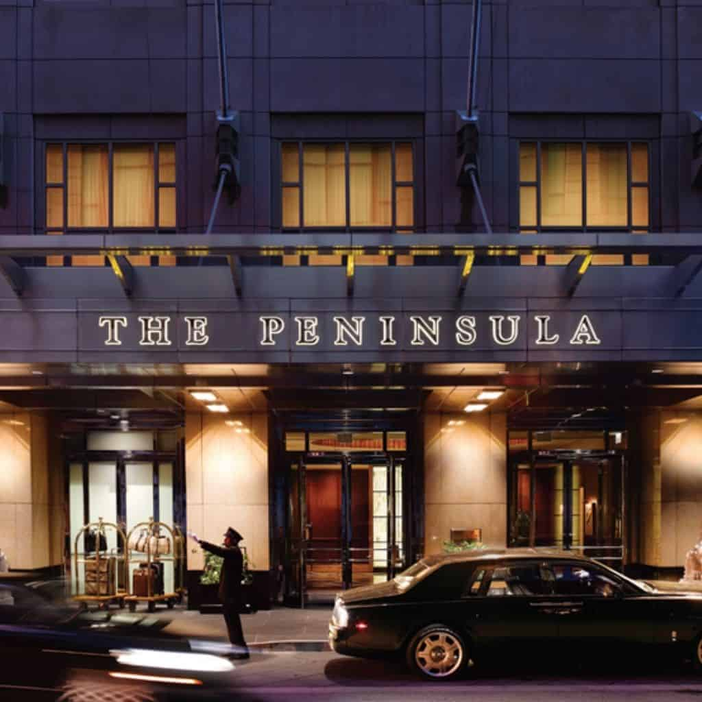 Exterior of The Peninsula hotel in Chicago at night.