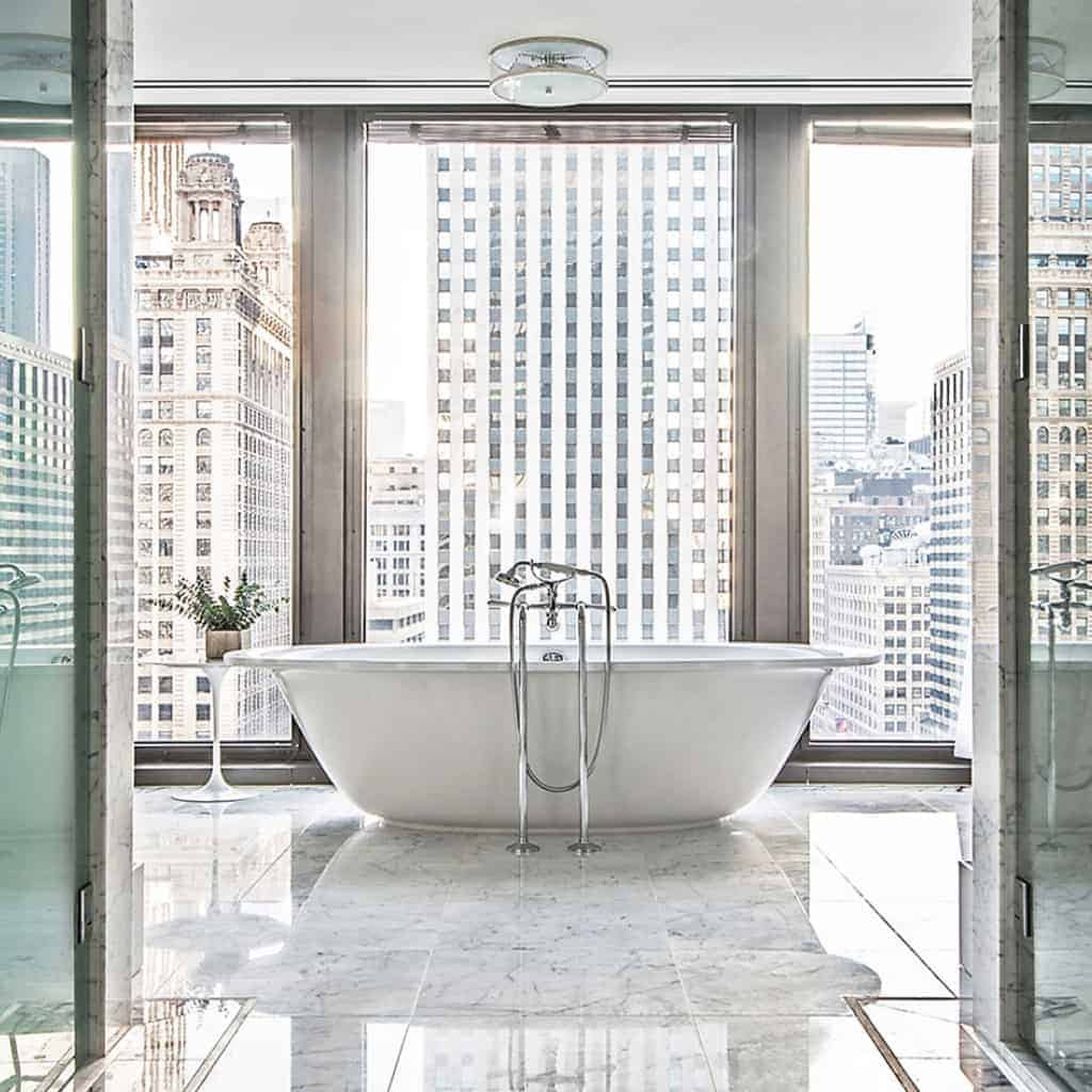Soaking tub with a view of buildings at The Langham hotel in Chicago.