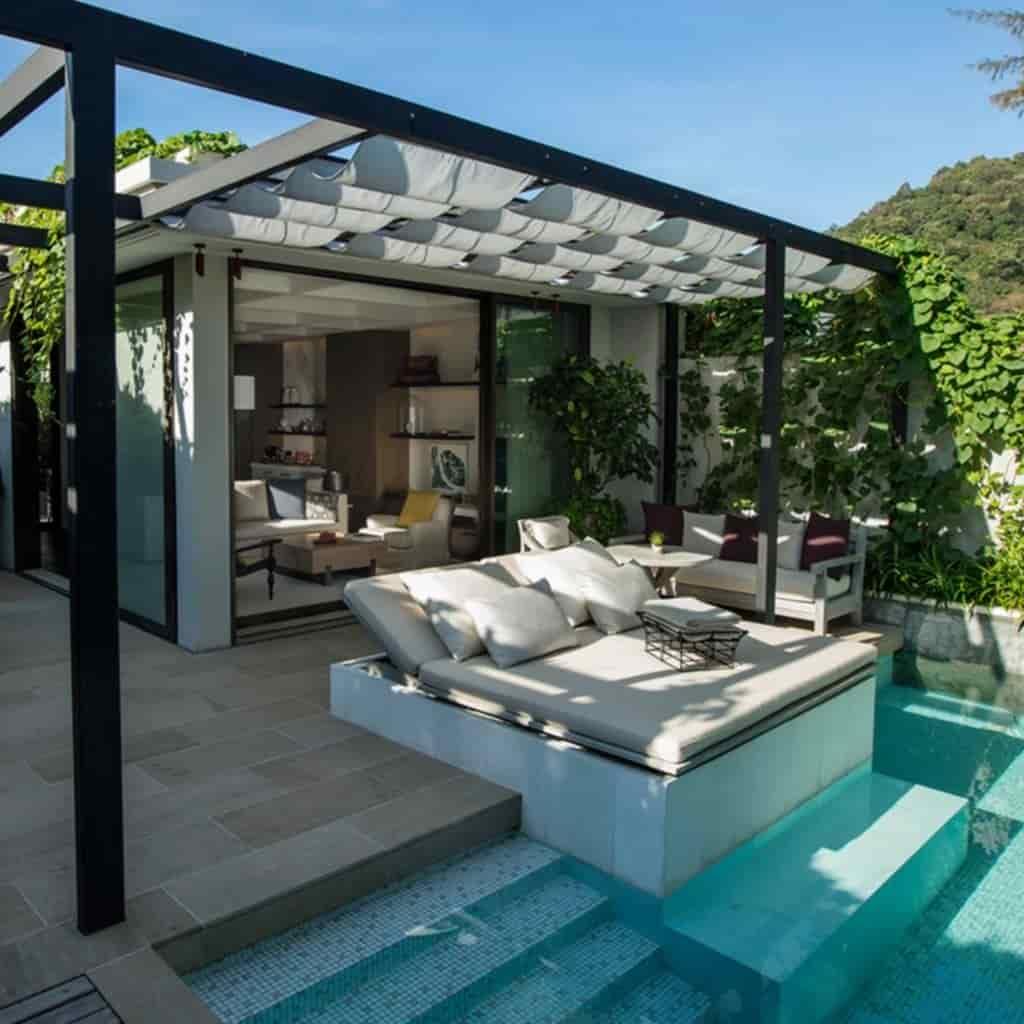Pool and villa at Rosewood Phuket resort.
