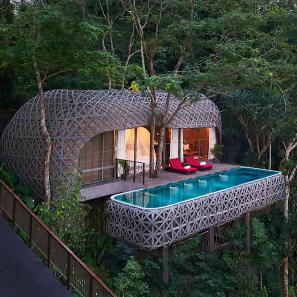 Pool and villa surrounded by trees at Keemala resort in Phuket.