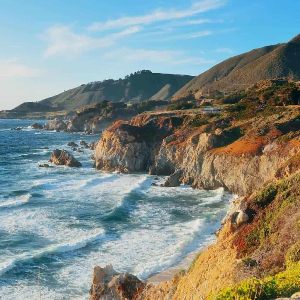 Big Sur mountains and waves during the day.